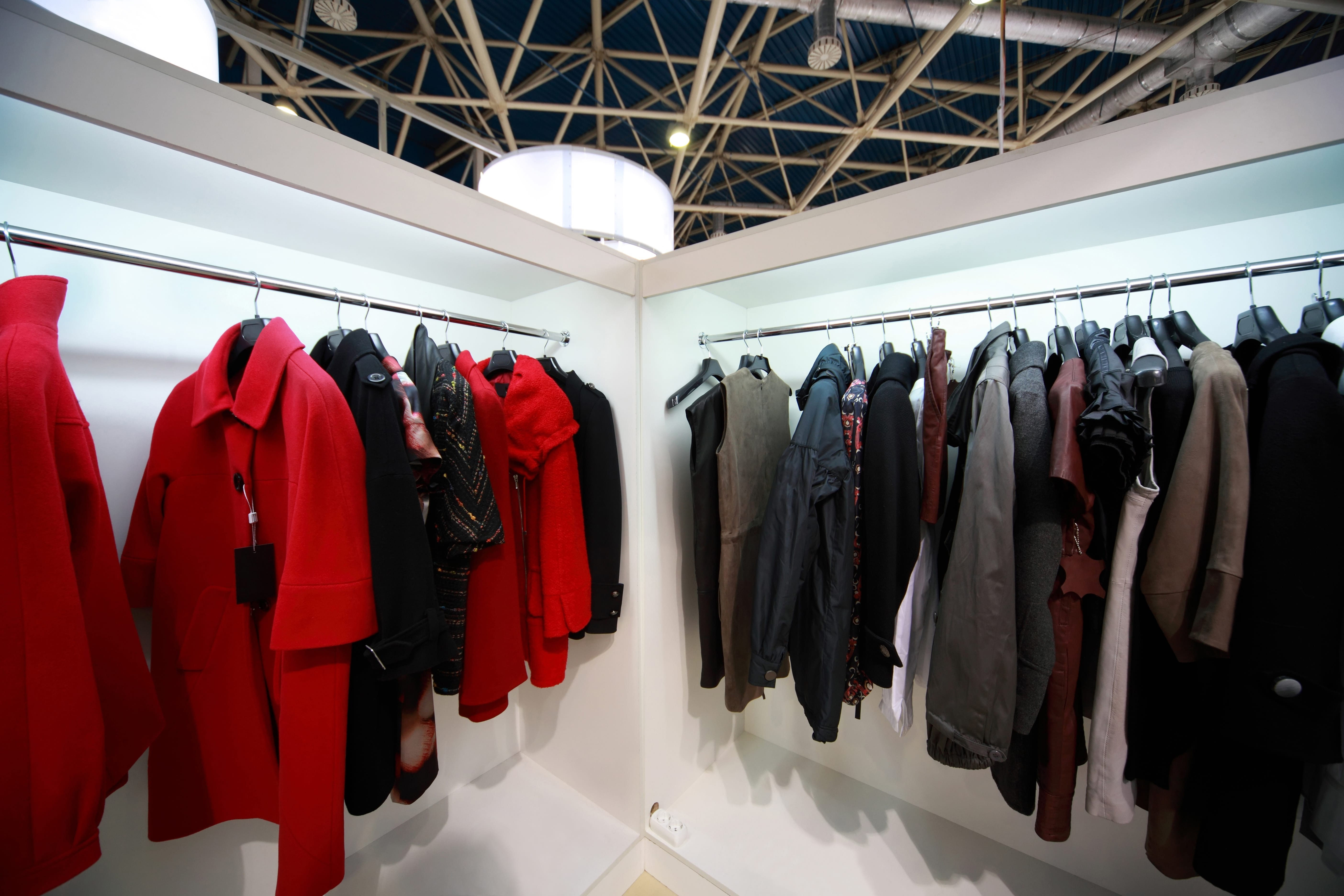Firm outer clothing hangs at demonstration stands in showroom